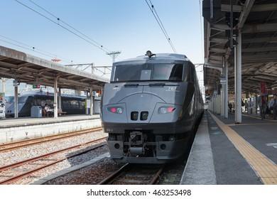 """NAGASAKI,JAPAN - MAY 30,2014: The limited express train """"Kamome (Black Seagull)"""" at Nagasaki station. This train use 787 Series train operated by JR Kyushu in Fukuoka (Hakata) - Saga - Nagasaki route."""
