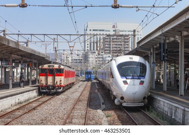 "NAGASAKI,JAPAN - MAY 30,2014 : The limited express train ""Kamome (Seagull)"" and local train at Nagasaki station. Kamome use 885 Series train operated by JR Kyushu in Fukuoka (Hakata) - Nagasaki route."