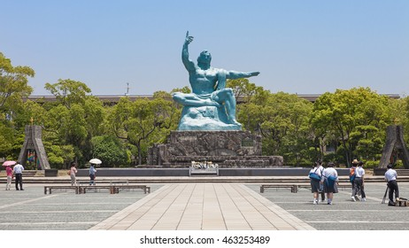 NAGASAKI,JAPAN - MAY 30,2014 : The  peace statue in the Nagasaki peace park. This bronze statue is 9.7 meters high, sitting on a 3.9 meter base, and weighs some 30 tons.