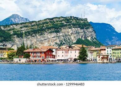 Nago - Torbole, Lago di Garda (Lago Benaco) / Italy - August 16, 2014: Coastal promenade of town Torbole in Lake Garda