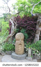 "Nagomi Jizo of Hase Temple in Kamakura, Japan.Chinese characters mean ""feel relieved Jizo""."