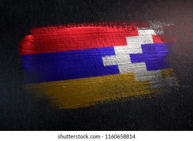 Nagorno-Karabakh Republic Flag Made of Metallic Brush Paint on Grunge Dark Wall