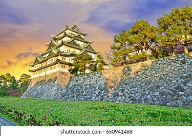 Nagoya Castle with evening sunlight and twilight sky in Nagoya City, Japan.
