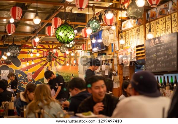 Nagoya, Japan - 15 March 2018: Isomaru Suisan, Izakaya restaurant and bar ,izakaya is a type of informal Japanese pub popular for after-work drinking.