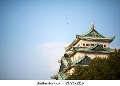 """Nagoya, Japan - 23. January 2019: Nagoya castle atop with golden tiger fish head pair called """"King Cha Chi"""", Japan. Nagoya-juku."""