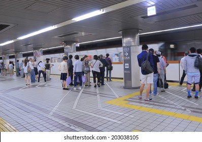 NAGOYA JAPAN - 31 MAY, 2014:Unidentified people wait for subway at Nagoya subway station. The Nagoya subway system covers 93.3km of route, serving 87 stations.