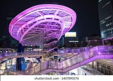 Nagoya, Japan - April 07, 2019:  Oasis21 light up architecure with Nagoya TV tower at night. Famous travel destination and shopping business area at Aichi, Chubu region.