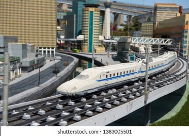 Nagoya, Japan - April 08, 2019: Shinkansen lego model running on railway with city background of Japan Legoland. Famous theme park landmark espcially for children age around 1 to 7 years old.