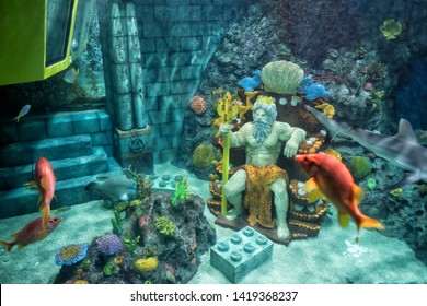 Nagoya, Japan - April 08, 2019:  Poseidon lego model with many fish and shark at Underwater Submarine in Japan Legoland. Famous theme park landmark espcially for children age around 1 to 7 years old.