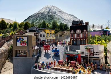 Nagoya, Japan - April 08, 2019: Lego bricks made famous Japanese Noboribetsu landmark in Hokkaido, giant demons and Jigokudani hell valley and mountain at lake toya  in Legoland miniature city.