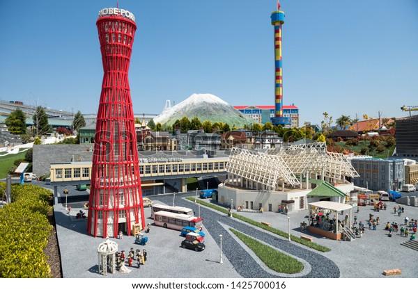 Nagoya, Japan - April 08, 2019: Lego bricks made famous Kobe port with red observation tower landmark and moutnain Fuji background in legoland theme park miniature city.
