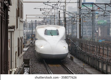 "NAGOYA , JAPAN - APRIL 1: The N700A Series train on April 1 , 2015 in Nagoya, Japan. It services as super express (or high-speed train) ""Nozomi(Hope)"" for Tokaido Shinkansen (Osaka - Tokyo route)."