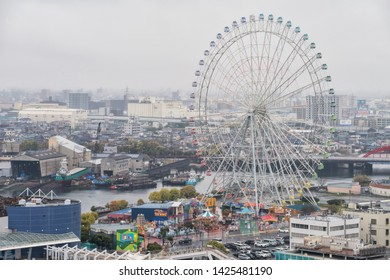 Nagoya, Japan - April 10, 2019: top cityscape view from observation dock of Nagoya port with ferris wheel. Here is 1 of 10 famous Nagoya landmarks based on Trip Advisors poll.