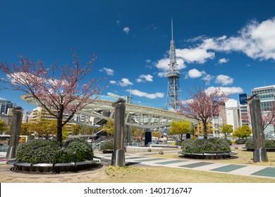 Nagoya, Japan - April 11, 2019: city view of Oasis21, Nagoya TV tower, and Odori park with pink sakura or cherry blossom at Sakae district. Famous travel and shopping destination in Aichi, Chubu.