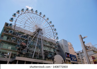 NAGOYA, JAPAN - APRIL 15, 2019: Sunshine sakae shopping mall with Ferris wheel in the front of the building, Nagoya, Japan