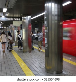 NAGOYA, JAPAN - APRIL 28, 2012: Commuters wait for Nagoya Subway in Nagoya, Japan. Nagoya Subway is among top 30 busiest metro systems worldwide with 427 million annual rides.