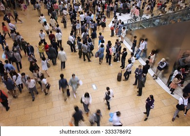 NAGOYA, JAPAN - APRIL 28, 2012: Travelers hurry at Nagoya Station in Japan. It exists since 1886 and is one of the world's largest train stations by floor area (410,000 m2).
