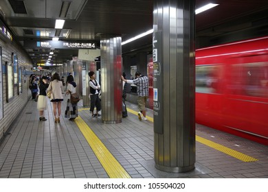 NAGOYA, JAPAN - APRIL 28: Commuters wait for Nagoya Subway on April 28, 2012 in Nagoya, Japan. Nagoya Subway is among top 30 busiest metro systems worldwide with 427 million annual rides.