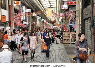 NAGOYA, JAPAN - APRIL 28: Shoppers walk along Osu Kannon covered shopping street on April 28, 2012 in Nagoya, Japan. Tripadvisor says it is currently among top 10 places worth visiting in Nagoya.