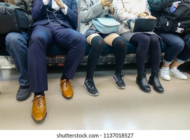Nagoya, Japan - Dec 3, 2016. Legs of passenger in the local train in Nagoya, Japan. Trains are a very convenient way for visitors to travel around Japan.