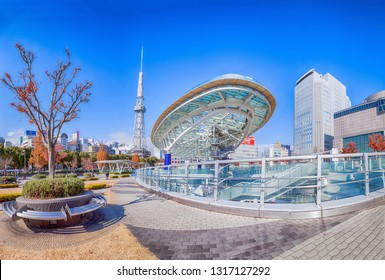 NAGOYA, JAPAN - December 09, 2017: Cityscape of Nagoya in autumn Oasis 21 and Nagoya TV Tower in Sakae, Japan., A shopping complex and its large oval glass roof structure floats above ground level.