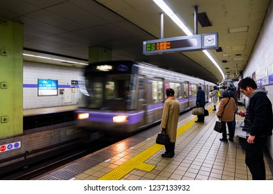 NAGOYA, JAPAN - FEBRUARY 14, 2018: Passengers waiting train on platform of Rokuban-Cho Station in Nagoya. The blurry moving subway arrive to station in Meiko Line of Nagoya Municipal Subway.