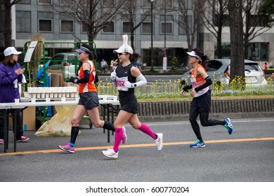 NAGOYA, JAPAN - MARCH 13, 2016: Nagoya Women's Marathon 2016. Women's running in the downtown. in motion blur.Course Start and finish at Nagoya Dome Distance 42.195km. Nagoya city Japan.