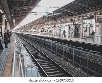 Nagoya, Japan - March 16, 2009: Shinkansen track and platform at Nagoya station with crowd of people waiting for the train
