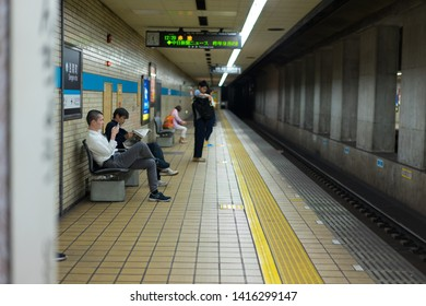 Nagoya, Japan - May 11, 2019: Nagoya, Japan - Passengers waiting for a subway train at Sengen-cho Station.