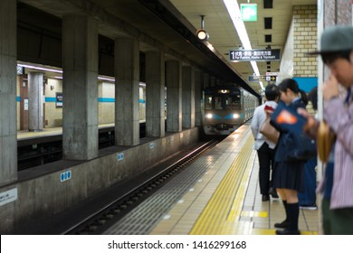 Nagoya, Japan - May 11, 2019: Passengers waiting for a subway train at Sengen-cho Station.