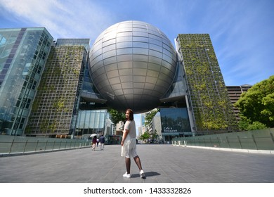 Nagoya, Japan -  May 22, 2019 : Traveler woman visiting The Nagoya City Science Museum ( Nagoya-shi Kagakukan) features a characteristic giant silver globe, one of the world's largest planetariums.