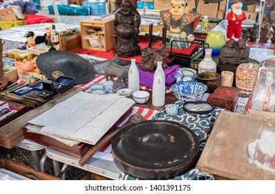 NAGOYA, JAPAN - NOVEMBER 28, 2015: Maps, small Buddha statues and other homeware sold at flea market in Nagoya. Japan