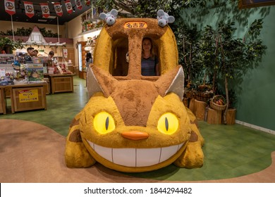 Nagoya, Japan - September 17, 2019: The ghibli cat bus with a caucasian girl in a shop.