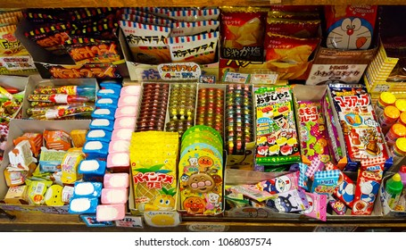 Nagoya, JP - OCTOBER 19, 2017: Various of Japanese vintage snacks and candies sell on a shelf for kids.