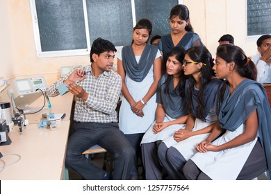 NAGPUR, MAHARASHTRA, INDIA, 11 APRIL 2016 : University professor demonstrating and teaching young students of  Engineering at the workshop, Engineering Students studying and working together.