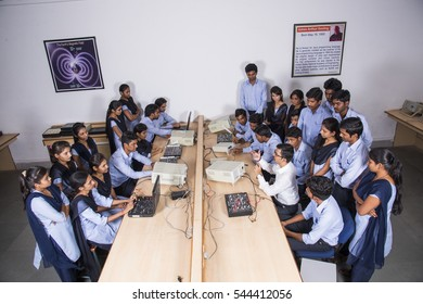 NAGPUR, MAHARASHTRA, INDIA, 11 APRIL 2016 : university professor demonstrating and teaching young students of Information Technology Engineering at the classroom.