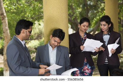 NAGPUR, MAHARASHTRA, INDIA, 13 APRIL 2016 : unidentified young cheerful students of MBA talking together about their studies project at university campus.