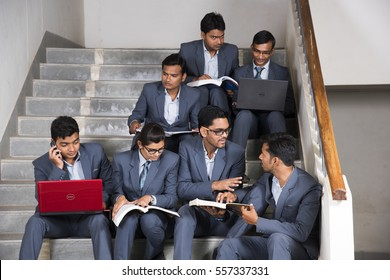 NAGPUR, MAHARASHTRA, INDIA, 13 APRIL 2016 : unidentified young MBA students talking together about their studies project on the staircase at university campus.