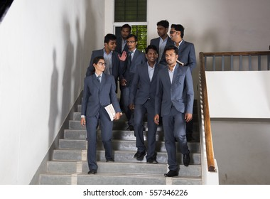 NAGPUR, MAHARASHTRA, INDIA, 13 APRIL 2016 : Unidentified group of young MBA students talking together about their studies project and walking at MBA Department in university campus.