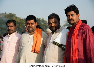 NAGPUR, MAHARASHTRA, INDIA 26 OCTOBER 2017 : Unidentified traditionally dressed indian people come together for pray and celebrating Chhath Puja Festival on riverside.