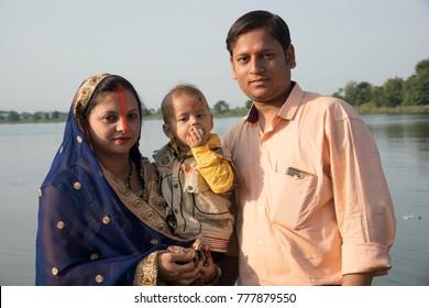 NAGPUR, MAHARASHTRA, INDIA 26 OCTOBER 2017 : Unidentified traditionally dressed indian women pray and devote celebrates Chhath Puja Festival on riverside.