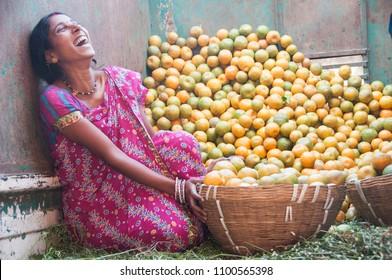 NAGPUR, MAHARASHTRA, INDIA 3 DECEMBER 2014 : Unidentified woman vendor selling oranges at the street of city Nagpur, Nagpur is known as Orange City.