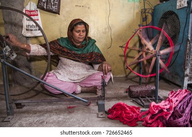 NAGPUR, MAHARASHTRA, INDIA 4 DECEMBER 2016 : Unidentified Indian woman weavers Removing knots of silk yarn for weaving sari on loom. Nagpur is famous for hand woven traditional sarees.