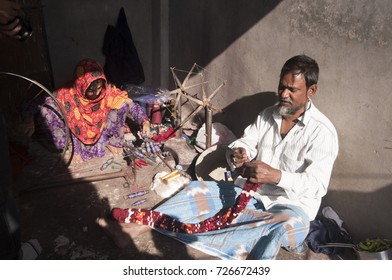 NAGPUR, MAHARASHTRA, INDIA 4 DECEMBER 2016 : Unidentified Indian woman weavers Removing knots of silk yarn and make ready for weaving sari on loom. Nagpur is famous for hand woven traditional sarees.
