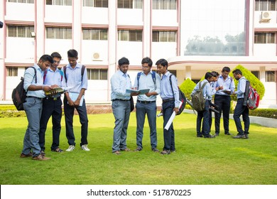 NAGPUR, MAHARASHTRA, INDIA, 9 APRIL 2016 : unidentified young cheerful university students talking together about their studies project at university campus.