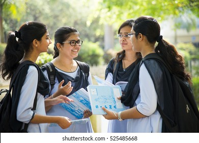 NAGPUR, MAHARASHTRA, INDIA, 9 APRIL 2016 : unidentified group of young girl university girl students talking together about their studies project at university campus.