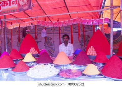 NAGPUR, MAHARASHTRA, INDIA, 9 JANUARY 2017 : Unidentified street vendor selling color and other goods for hindu festival to rural people at street market in village, Rural people lifestyle of india