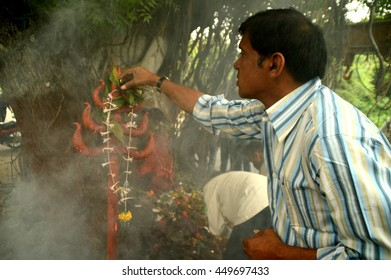 """NAGPUR, MAHARASHTRA, INDIA - AUGUST 01 : People worship of Snake God in """"Nag Panchami"""" festival. It is traditional worship of snakes or serpents observed by Hindus in Nagpur, India on 01 August 2014"""
