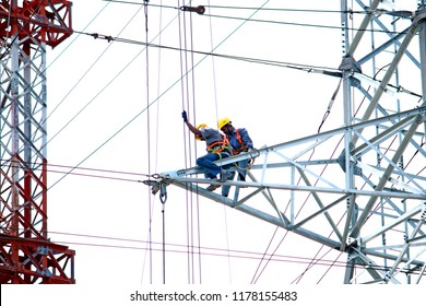 NAGPUR-INDIA-JUNE 26 : Transmission line tower & worker at test station for tower load test, June 26, 2015 Nagpur Province, India