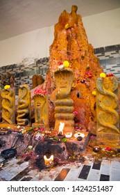 Nagula Chavithi, a festival to worship Nag Devatas. Pamula Putta. Snake Hole. Snake House red colored mud or soil  - Image